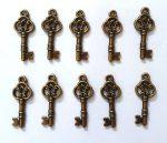 Fém díszítőelem, kulcs 2,5*0,8cm, 10/cs 38198